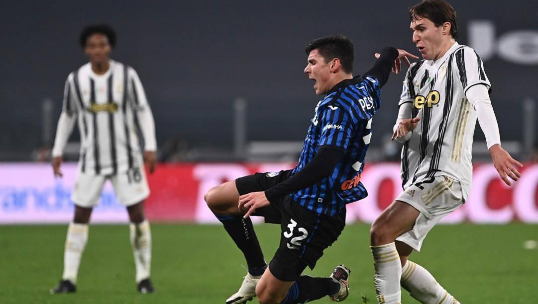 Matteo Pessina in azione contro lla Juve. Afp