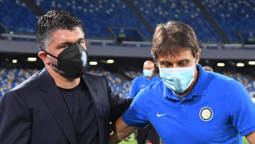 Antonio Conte con Rino gattuso prima dell'eliminazione dall'ultima Coppa Italia. LaPresse