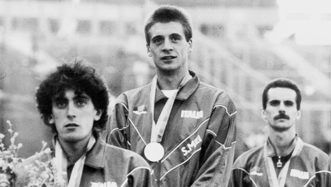 Stefano Mei sul gradino più alto del podio dopo i 10mila metri degli Europei '86: insieme a lui Antibo e Cova. Ap