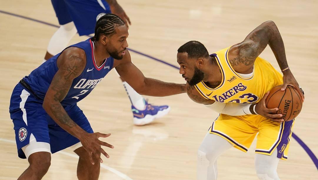 Kawhi Leonard, 29 anni, e LeBron James, 36, i simboli di Clippers e Lakers. LaPresse