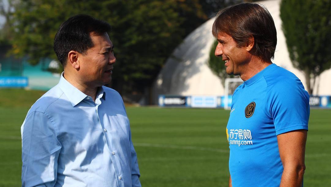 Zhang Jindong con Antonio Conte. Getty