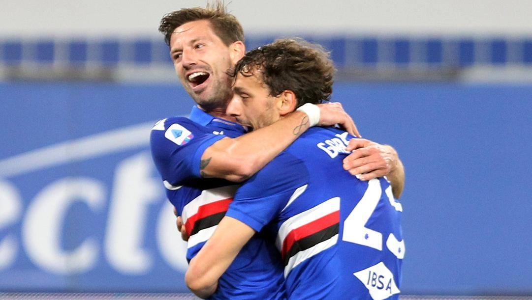 A sinistra Adrien Silva abbracciato da Gabbiadini. Lapresse