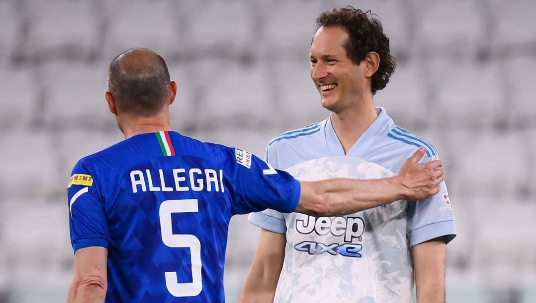 Massimiliano Allegri, 53 anni, con John Elkann, 45. Afp