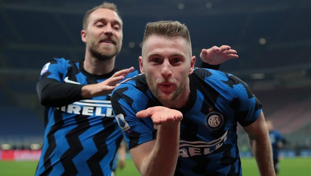 Milan Skriniar con Christian Eriksen dopo il gol all'Atalanta. Getty