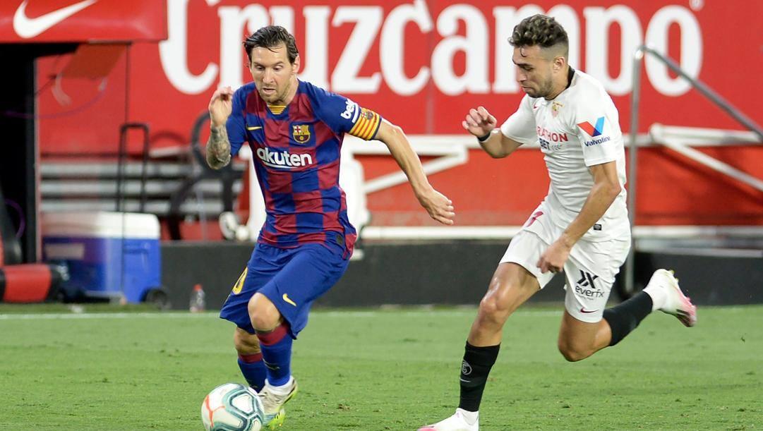 Lionel Messi e Munir El Haddadi in maglia Siviglia. Afp