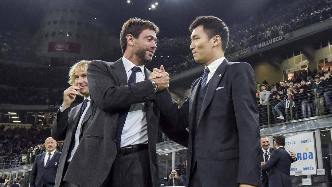 Il saluto tra Andrea Agnelli  e Steven Zhang. Getty